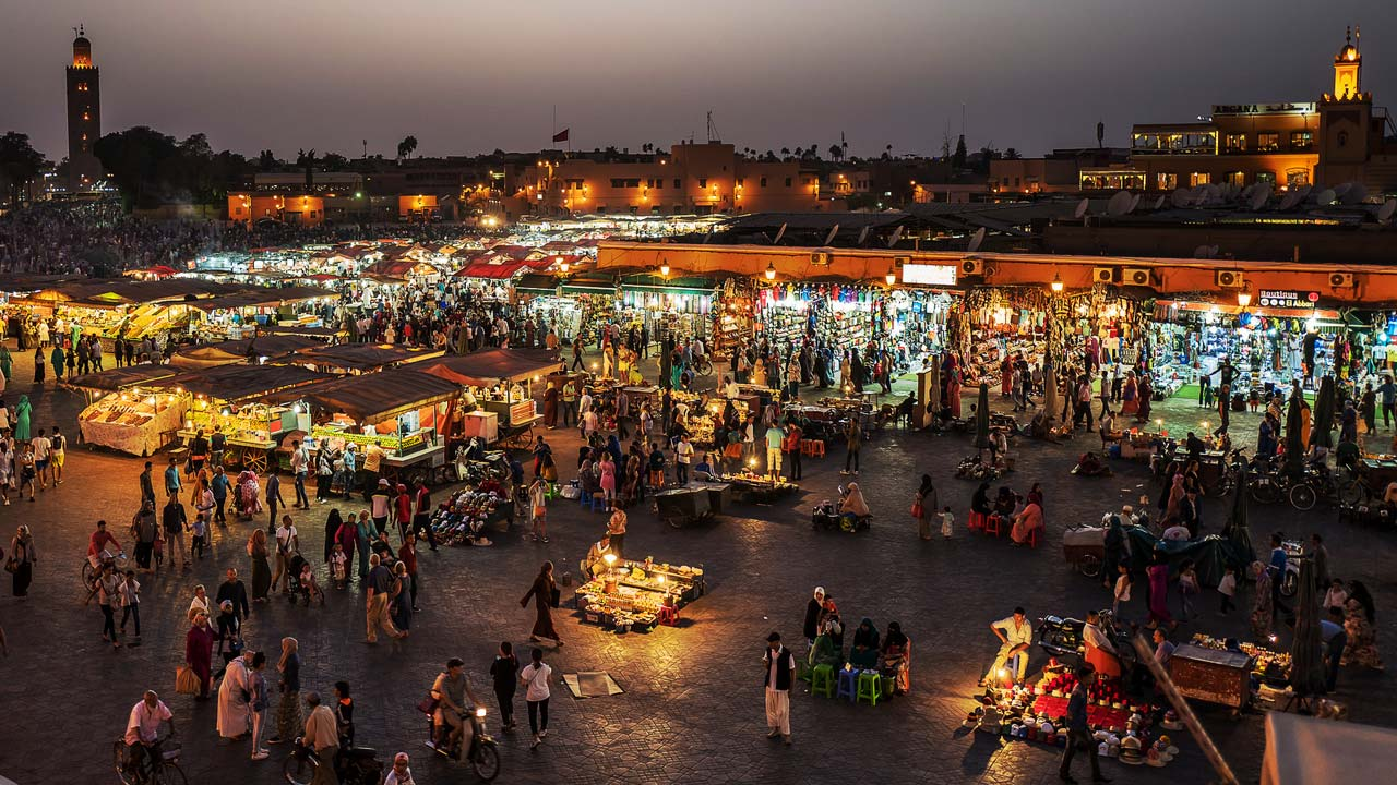 [the Jemaa el-Fnaa market place at night]